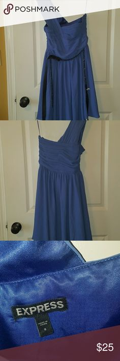 Periwinkle dress from Express Beautiful colored dress with pewter accent chain belt.    Perfect for wedding season. One shoulder. Really flowy. Side zipper. Hits just at knee. Worn once. Express Dresses One Shoulder