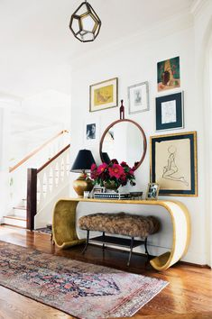 Our wildest entryway dreams come true, this style-focused hallway is the epitome of drama and luxury, thanks to the striking mid-century mirror and Karl Spring table—which add surprising intrigue and shape to an eclectic gallery wall.
