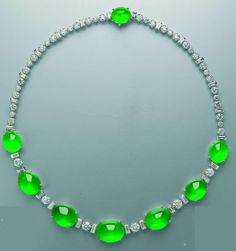 An important jadeite cabochon and diamond necklace. Wow!