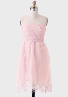 ruche Delicate tulle overlay adorns this dusty pink strapless dress featuring intricate pleating at the bodice and embroidery at the skirt. Perfected with scalloped crocheted hems, padded cups, and a h...