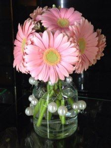 Vintage jar wrapped in oasis mega beaded wire....large pink gerber daisies...perfect arrangement for a backyard picnic
