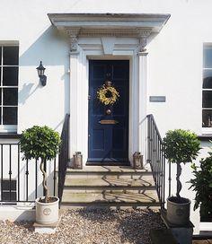 Georgian home front entrance. Bay trees. Blue front door. Dulux oxford blue. Spring door wreath.
