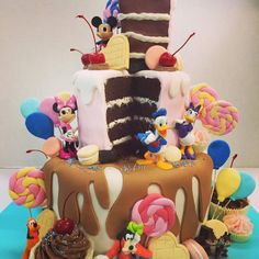 Disney decorations and fondant candies on this over the top cake