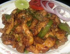 Here is yet another hot chicken favorite of My Dhaba - the chilly chicken. Chicken being the common meat we have at home, we learned that ki. Veg Recipes, Curry Recipes, Indian Food Recipes, Asian Recipes, Cooking Recipes, Indian Foods, Dishes Recipes, Chinese Recipes, Easy Recipes