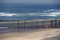 Tijuana, Mexico.  End of Border Fence with US at Pacific Ocean, 1995.  Thomas Hoepker.  Magnum Photos.