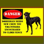 A funny twist on the beware of dog sign. Doberman needs new chew toy, volunteers encouraged to climb fence.