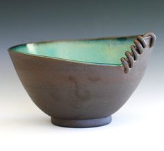 "Kazem Arshi, Orange County, Calif. ""This modern hostess bowl is wheel thrown and hand modified. The Black Mountain clay used for this bowl is fired to a deep, rich brown. The exterior is left unglazed, enhancing the natural texture of the clay. The glazed turquoise interior give the piece a brightness of color, along with a contrast in texture with the natural clay. All of my glazes are high fire, food, dishwasher and microwave safe."""