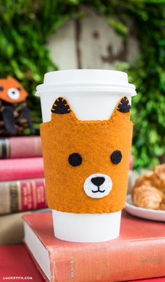 DIY Fox Coffee sleeve - Make your own super-cute felt coffee sleeves for teachers, your BFF or as a cute handmade treat for yourself! Pattern and tutorial by Lia Griffith.