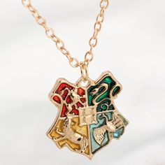 Harry Potter Hogwarts Badge Pendant Necklace <<< WANT! Hey relatives, enough with the clothes – I'm not Dobby! Get me something like this!