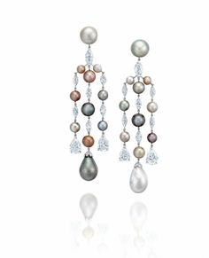 An elegant pair of natural pearl and diamond ear pendants, by G