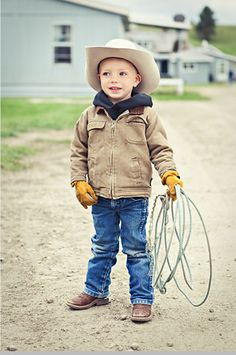 All my boys will grow up in Wranglers, Carhartts & boots!  This cowboy is Wiley Porter.  (Of course, we nicknamed him Coyote).
