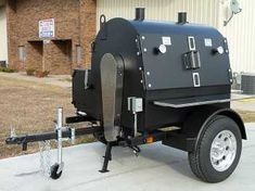 Very large black cabinet with a dome shaped top mounted on a trailer with wheels and parked in a parking lot There are two doors on the right side and two chimneys on the domed top. Bbq Smoker Trailer, Bbq Pit Smoker, Barbecue Pit, Bbq Grill, Custom Bbq Smokers, Custom Bbq Pits, Best Bbq Smokers, Meat Smokers, Rotisserie Smoker