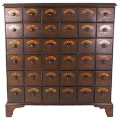 Tall Antique English Bank of Flower Seed Drawers.  WANT