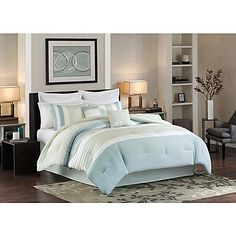 Transform your bedroom into a tranquil oasis with the Beachwood Comforter Set. This spa-color comforter set uses a mixture of light blues and greens with clean lined pleats for a nice visual effect.