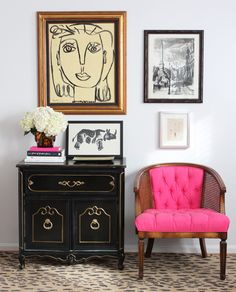 Reupholstered vintage cane chair and fantastic artwork.