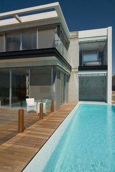 Ceasaria, villa E. IL  Size: 300 sq.m. Status: completed 2008  The villa is located in the new Golf quarter in Ceasaria.  In the base of the design was the notion of unified visual perception of