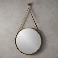 """Shop victor leather 24"""" mirror.   Rustic ranch house meets cozy Beaver Creek cabin—-pendant mirror has all the charm of the wide open with a thoroughly urban outlook."""