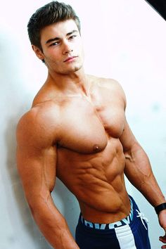 Amazing muscled guy showing his muscles