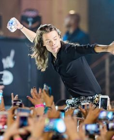 Why does it look like he's bowling with a water bottle and the fans are the pins?