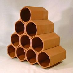 wooden wine rack. could be made. looks like a bee hive, but the inability to bend metal makes this un-doable