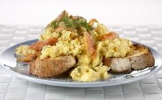 Srambled Eggs & Smoked Trout.  5 large eggs  2 Tbsp finely chopped flat leaf parsley  1/2 tsp of finely chopped fresh dill  2 Tbsp butter  170gm (6 ounces) thinly sliced smoked trout or salmon  A bunch of asparagus, tough ends removed  Wholegrain bread for two  Sea salt and freshly ground black pepper for seasoning