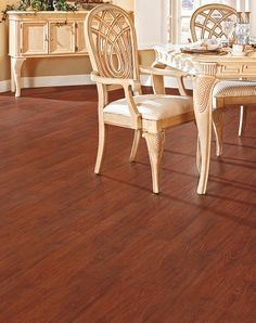 Add warm cherry wood tones with this easy-to-install Allure plank flooring. It's not only resilient and waterproof but also snaps together over your existing floor! Great for high-moisture areas like basements, kitchens, mudrooms and more. Soft Flooring, Flooring Store, Plank Flooring, Vinyl Flooring, Hardwood Floors, Allure Flooring, Laminate Flooring For Basement, Waterproof Laminate Flooring, Carpet Sale