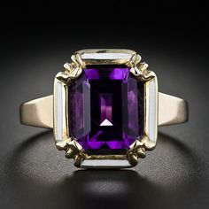 Very nice amethyst ring but I don't particularly care for the white enamel. Love the framing but think it would be better with baguettes or princess cut diamonds. Of course, that would take away the simplicity