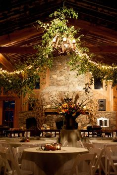 wedding reception venue : barn-style, garland draping from chandelier