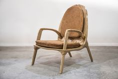 Stratus chair by Ammar Kalo.Materials: Baltic Birch Plywood, Untreated Camel Leather. Year:2016.