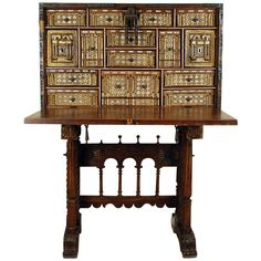 (Chapter 11) The Vargueno was a writing cabinet with a folding front that was a hinged lid to the top. It had numerous compartments and drawers. It was highly decorated with more decoration on the inside. This is my favorite desk! (16th Century Spanish Walnut Vargueno)