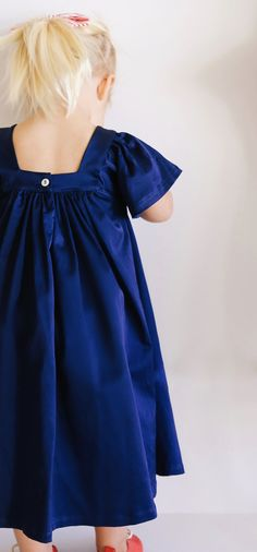This dress is a cotton/satin/spandex blend. The Holly Dress has plenty of room to grow and we suggest to size down from your little's regular size. Poppy Dress, Room To Grow, Poppies, Cold Shoulder Dress, Navy, Celebrities, Cotton, Collection, Dresses