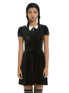 """Get creepy, kooky and totally girly in this little back dress! Black velvet dress with contrasting white collar, three white cloth buttons at the neckline and back single cloth button closure. Don't worry: ooky is definitely not a word that will be used to describe you while you're wearing it. Throw on your knee socks and saddle shoes and you're ready to go!<div><ul><li style=""""LIST-STYLE-POSITION: outside !important; LIST-STYLE-TYPE: disc !important""""&..."""