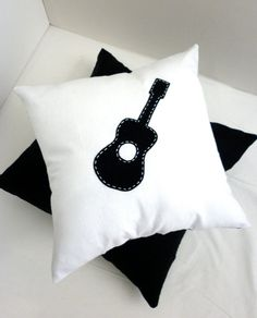 White guitar cushion with polka dot back by AlphabetMonkey on Etsy, $30.00