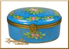 Tiffany & Company Blue Flowered Limoges. Limoges box is made in the traditional style with hand-painted flowers and 24K Gold embellishments.  The Limoges has been fired numerous times to achieve its brilliant colors.  The box is adorned with intricate metalwork and an ornate clasp.