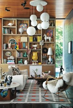 Jonathan Adler  - Bookcases don't have to have even rows of shelves -- or only house books.