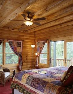 Log home bedroom with patio