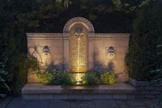 three lion heads lite at night showcase this wall that houses a beautiful water fountain Small Fountains, Outdoor Wall Fountains, Fountain Garden, Garden Water Fountains, Water Garden, Home Fountain, Outdoor Rooms, Outdoor Walls, Garden Art