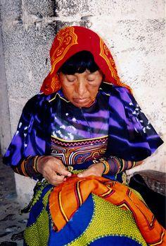 Native Guna (kuna) woman creating a mola. (Panama)