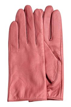 Leather gloves: PREMIUM QUALITY. Soft leather gloves with a press-stud fastener at the wrist. Lined.