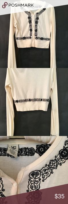 """Lucky Brand Embroidered Cropped Cardigen Adorable cropped cardigan to wear over a cute black dress or over a cute tank with jeans - super versatile! Beautiful detailed embroidery at bottom of long sleeves (27"""" from shoulder"""" and along the bottom, front and neckline. Body of cardigan is 17"""" from shoulder. Lucky Brand Sweaters Cardigans"""