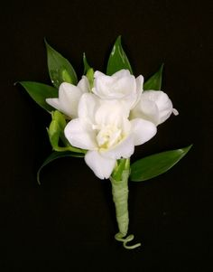 Freesia boutonniere for the groomsmen