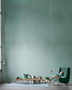 I like how the composition and quiet green gray wall color draws you into this interior still life photograph by Lerkenfeldt Photography. #green