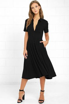 Make your presence known in the Tango in the Night Black Midi Dress! This…