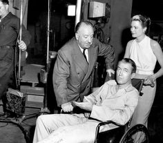 Alfred Hitchcock, James Stewart and Gene Kelly on set of Rear Window (1954)