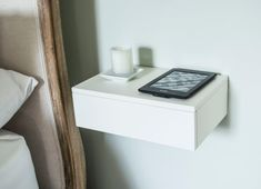 Solid beech floating bedside table in painted white. Super minimalist design for small bedrooms. Single floating drawer which attaches to the
