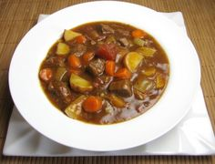 beef stew.  1 lb stew meat (lean round cut into small chunks).  1 sweet yellow onion chopped into large pieces.  6 cloves of garlic chopped.  1 tbsp olive oil.  1 can diced tomatoes.  1-2 tsp dried thyme.  Salt and pepper to taste.  2 bay leaves.  6 cups of beef stock.  1 cup diced carrots.  1 cup diced celery.  2 cups diced baby red potatoes (skin on).