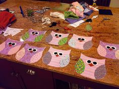 """Owl """"stuffies"""" assembly line."""