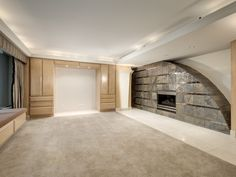 Stone fireplace with modern, round top