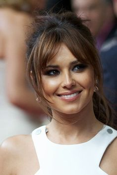 Cheryl's parted fringe is a great way to update a tired hairstyle.