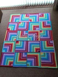 Giant mitered rainbow granny blanket. https://www.facebook.com/media/set/?set=a.661017313919985.1073741851.370000099688376&type=3
